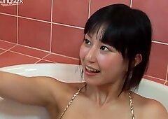 Cheerful Asian porn actress is having fun in the bathroom.